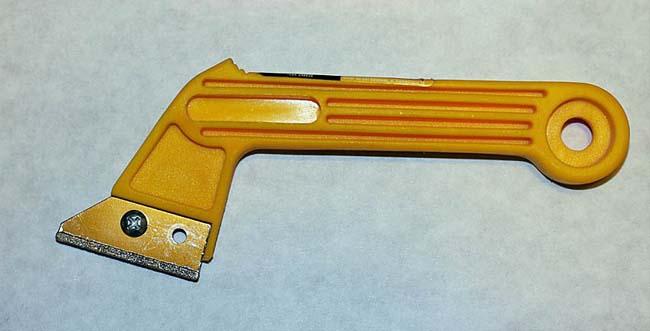 инструмент для очистки швов