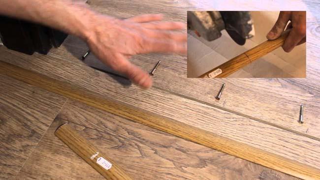 установка алюминиевого порожка на стыке материалов