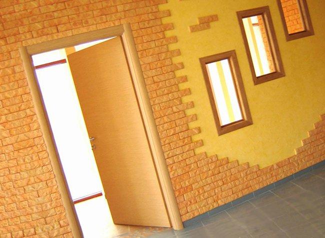 стильное оформление стены терракотовой плиткой
