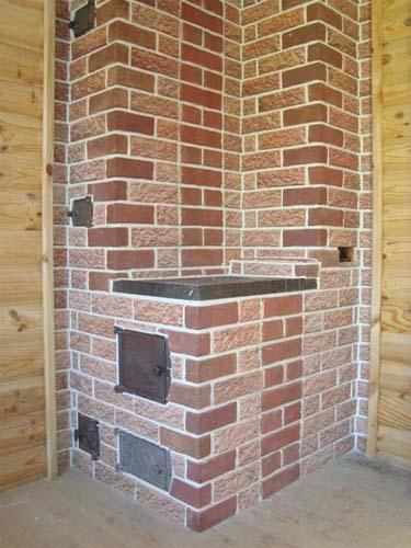 угловая печь обложенная терракотом сделает дом теплее