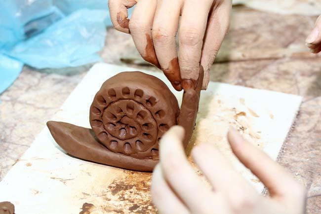 улитка из гончарной глины